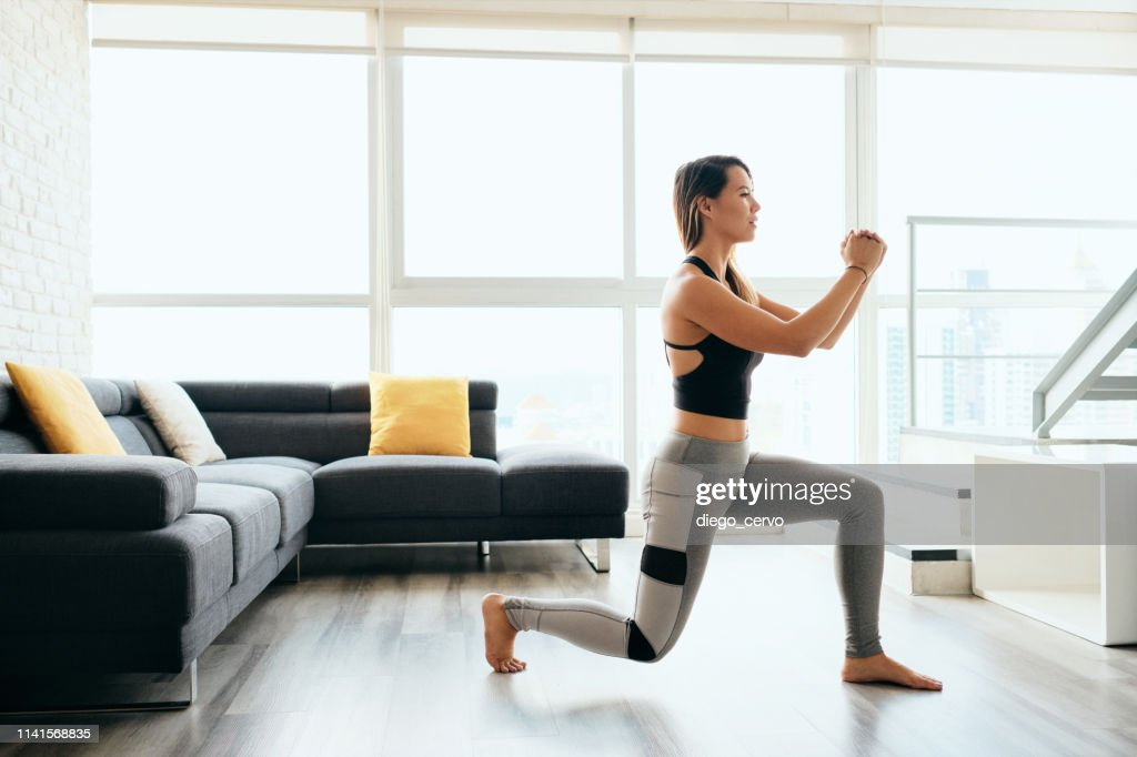 Adult Woman Training Legs Doing Inverted Lunges Exercise : Stock Photo
