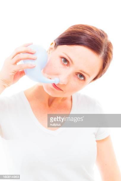 adult woman using neti pot