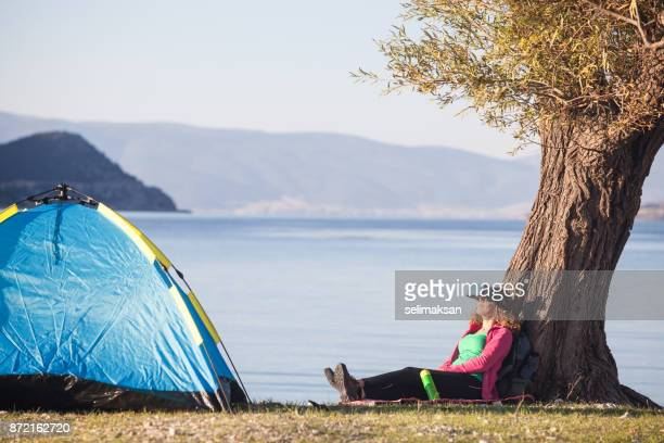 Adult Woman Using VR Glasses While Camping
