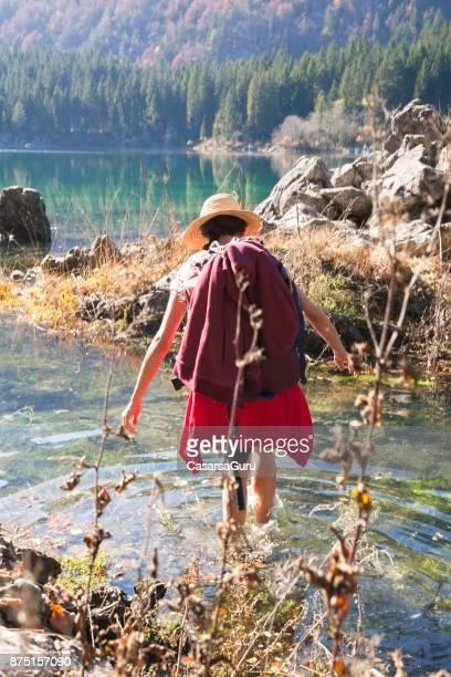 Adult Woman Walking Across Water of a Lake