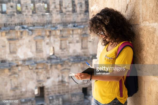 Adult Woman With Curly Hair In Antique Roman City Of Aspendos