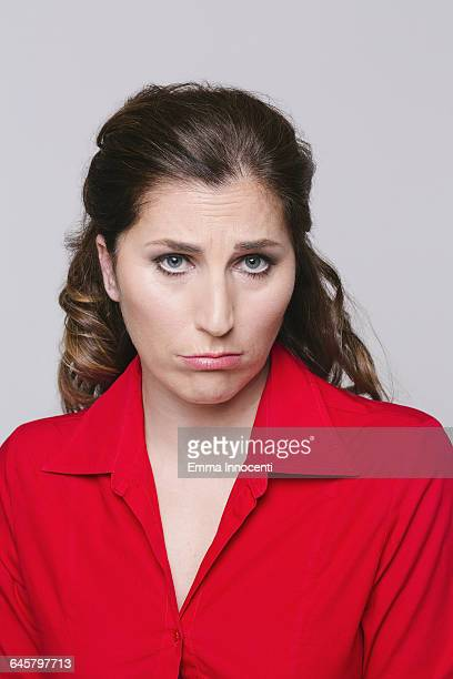 adult woman with red shirt - red shirt stock pictures, royalty-free photos & images