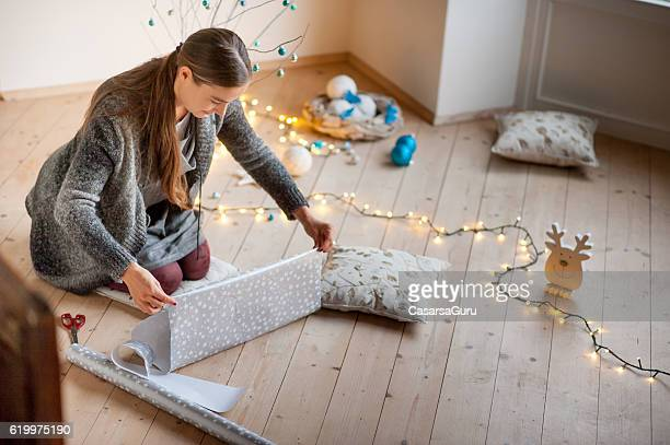 Adult Woman Wrapping Christmas Gifts