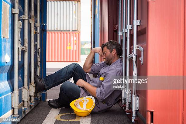 adult worker in large container port, sleeping
