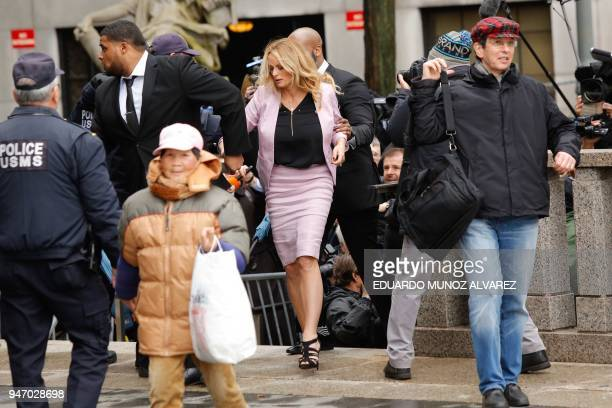 TOPSHOT Adultfilm actress Stephanie Clifford also known as Stormy Daniels arrives for a court hearing at the US Courthouse in New York on April 16...