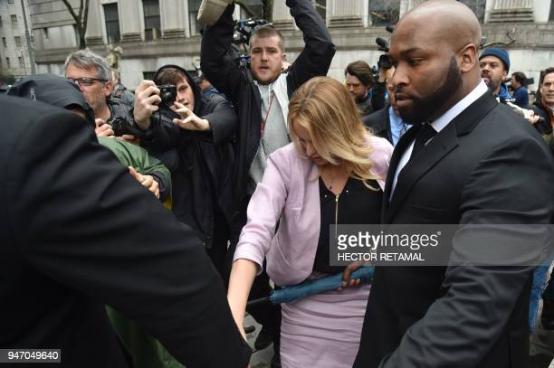 Adultfilm actress Stephanie Clifford also known as Stormy Daniels arrives for a court hearing at the US Courthouse in New York on April 16 2018...