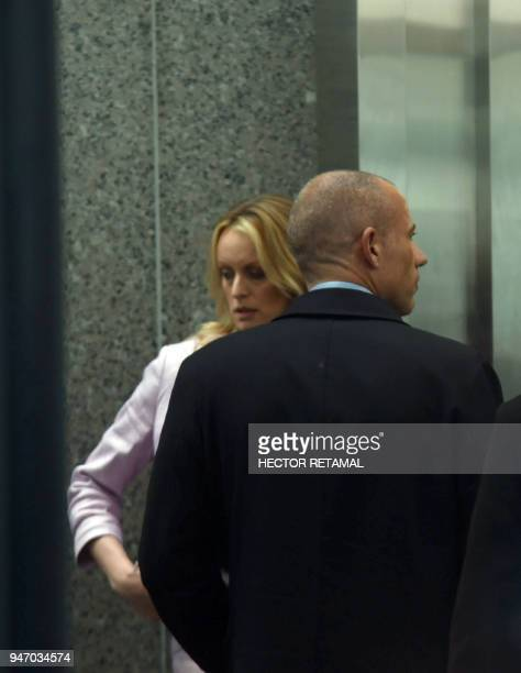Adultfilm actress Stephanie Clifford also known as Stormy Daniels stands with her lawyer Michael Avenatti as she arrives for a court hearing at the...