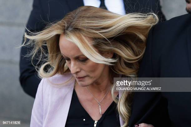 Adultfilm actress Stephanie Clifford also known as Stormy Daniels exits the US Federal Court on April 16 in Lower Manhattan New York President Donald...