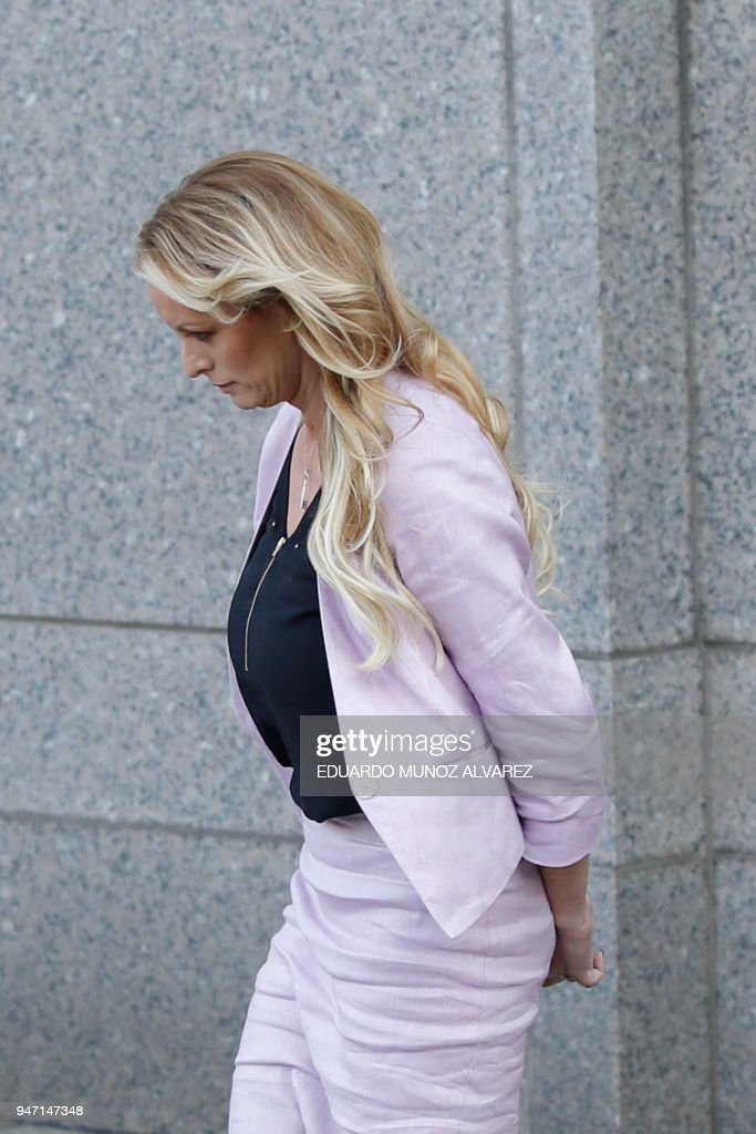 Adult-film actress Stephanie Clifford, also known as Stormy Daniels exits the US Federal Court on April 16, 2018, in Lower Manhattan, New York. President Donald Trump's personal lawyer Michael Cohen has been under criminal investigation for months over his business dealings, and FBI agents last week raided his home, hotel room, office, a safety deposit box and seized two cellphones. Some of the documents reportedly relate to payments to porn star Stormy Daniels, who claims a one-night stand with Trump a decade ago, and ex Playboy model Karen McDougal who also claims an affair. /