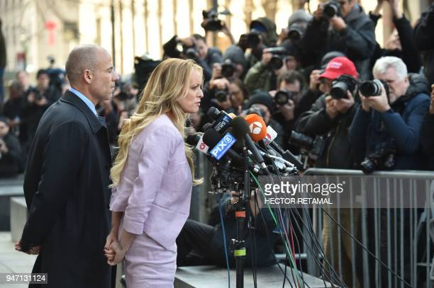 Adultfilm actress Stephanie Clifford also known as Stormy Daniels speaks to the media next to her lawyer Michael Avenatti after a court hearing...