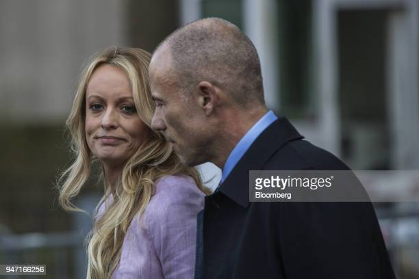 Adultfilm actress Stormy Daniels left pauses while speaking to members of the media while attorney Michael Avenatti listens outside Federal Court in...