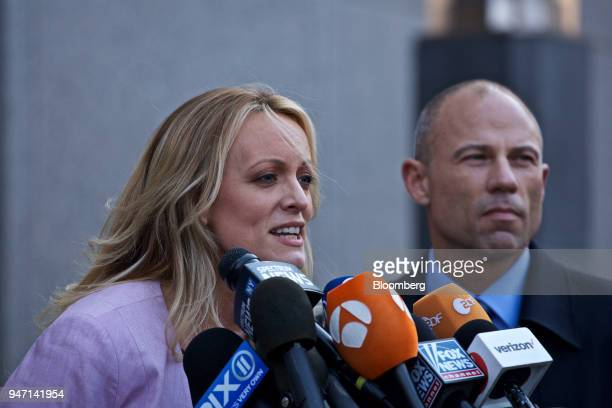 Adultfilm actress Stormy Daniels left speaks to members of the media while attorney Michael Avenatti listens outside Federal Court in New York US on...