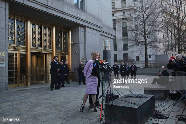 Adultfilm actress Stormy Daniels left speaks to members of the media outside Federal Court in New York US on Monday April 16 2018 Daniels claims she...