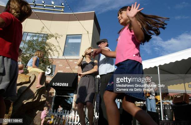 Adults and children alike dance to the music of the Tropical Coyotes playing at the Street Faire in the Village at FlatIron Crossing mall Thursday