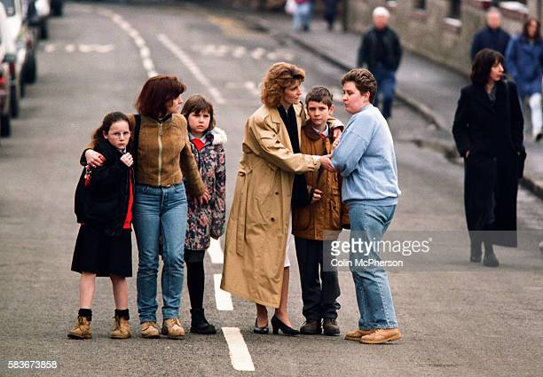 Adults and children comfort each other outside Dunblane primary school Scotland shortly after the shooting incident on the premises The Dunblane...