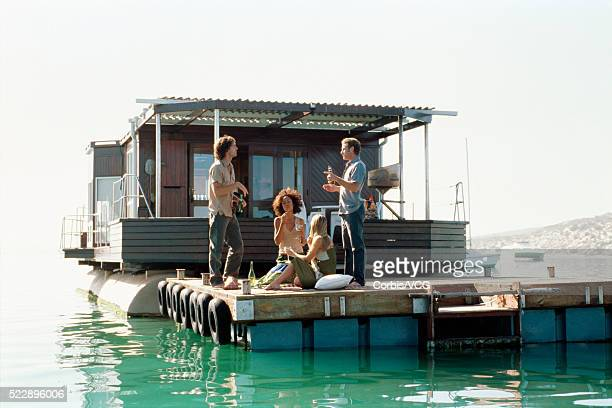 adults hanging out on a boat - houseboat stock pictures, royalty-free photos & images