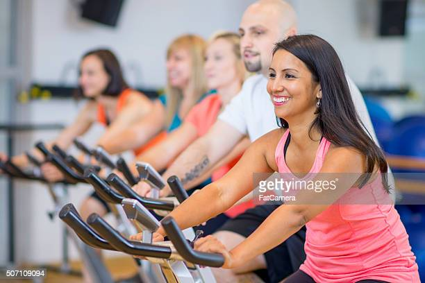 Adults Happily Taking a Spin Class