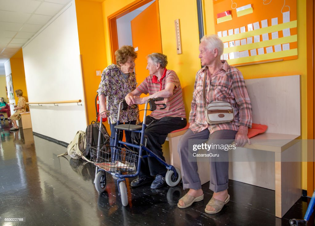 Adults Senior Socialize In The Hall Of Care Center : Stock Photo