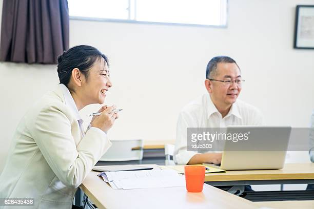 Adults students at a training seminar or further education classroom