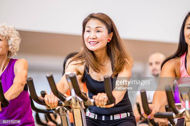 Adults Taking a Spin Class at the Gym