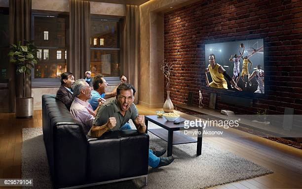 Adults watching  Basketball game at home