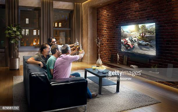 Adults watching Car sprint at home