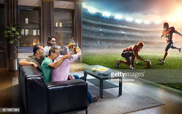Adults watching very realistic American football game at home