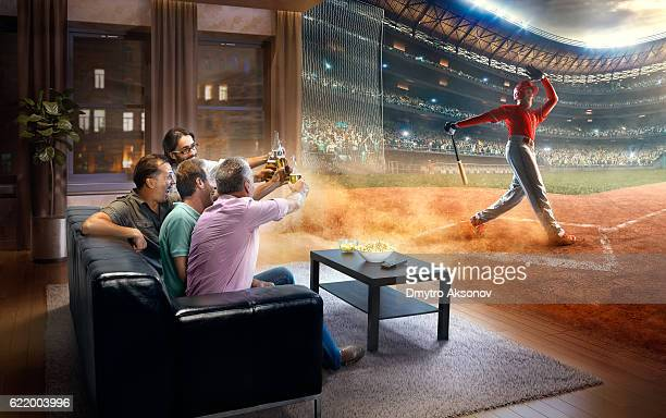 adults watching very realistic baseball game at home - baseball uniform stock pictures, royalty-free photos & images