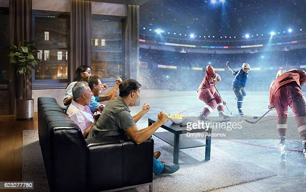 Adults watching very realistic Ice hockey game at home
