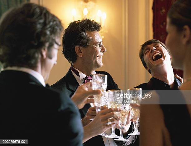adults wearing formal attire, toasting champagne glasses - exclusive stock pictures, royalty-free photos & images