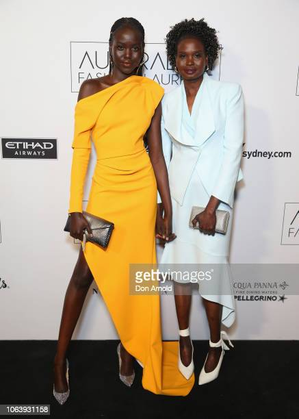 Adut Akech and Mary Akech pose at the 2018 Australian Fashion Laureate Awards on November 20 2018 in Sydney Australia