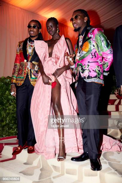 Adut Akech and Migos attend Heavenly Bodies Fashion The Catholic Imagination Costume Institute Gala at The Metropolitan Museum of Art on May 7 2018...