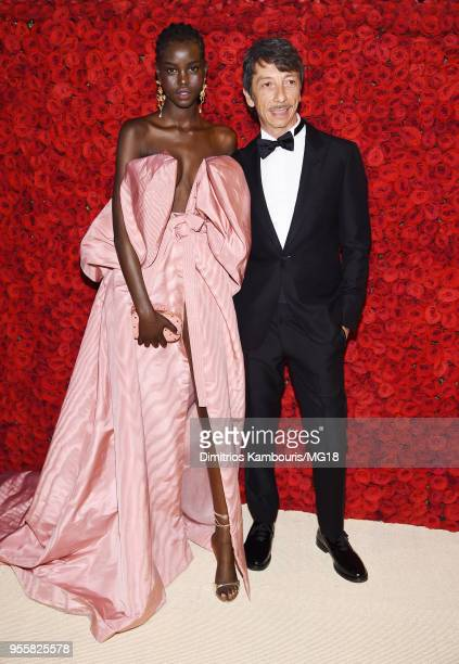 Adut Akech and Pierpaolo Piccioli attend the Heavenly Bodies Fashion The Catholic Imagination Costume Institute Gala at The Metropolitan Museum of...