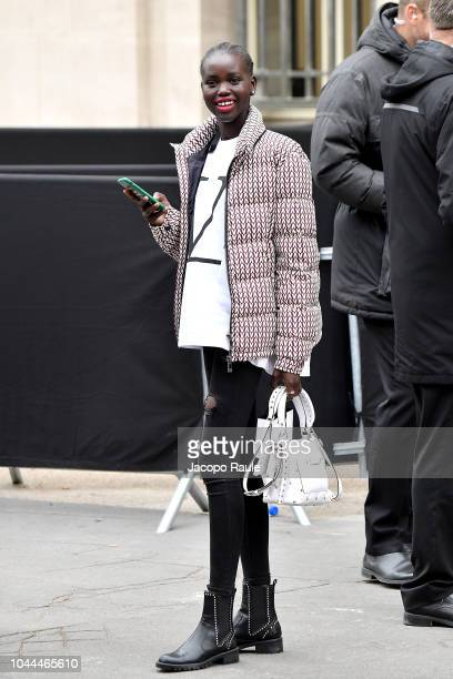 Adut Akech attends the Chanel show as part of the Paris Fashion Week Womenswear Spring/Summer 2019 on October 2 2018 in Paris France
