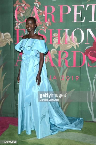 Adut Akech attends the Green Carpet Fashion Awards during the Milan Fashion Week Spring/Summer 2020 on September 22, 2019 in Milan, Italy.