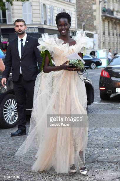 Adut Akech Bior arrives at the 'Vogue Foundation Dinner 2018' at Palais Galleria on July 3 2018 in Paris France