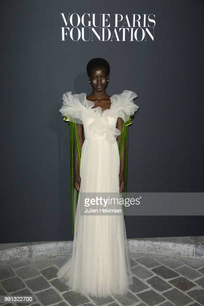 Adut Akech Bior attends Vogue Foundation Dinner Photocall as part of Paris Fashion Week Haute Couture Fall/Winter 20182019 at Musee Galliera on July...