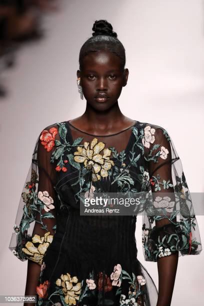 Adut Akech fashion detail walks the runway at the Fendi show during Milan Fashion Week Spring/Summer 2019 on September 20 2018 in Milan Italy