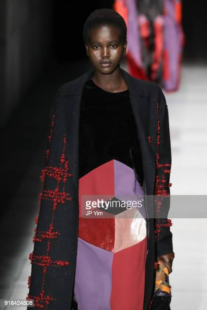 Adut Akech walks the runway at Bottega Veneta Fall/Winter 2018 Collection at the American Stock Exchange on February 9 2018 in New York City
