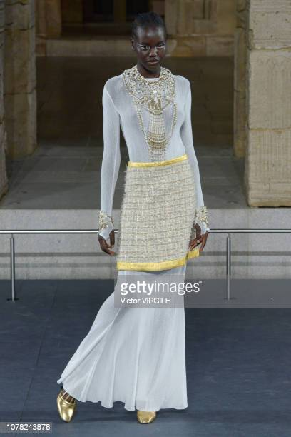 Adut Akech walks the runway at Chanel Metiers D'Art 2018/2019 Fashion show at The Metropolitan Museum of Art on December 04 2018 in New York City