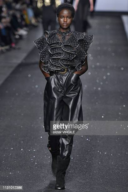 Adut Akech walks the runway at the Alberta Ferretti Ready to Wear Fall/Winter 20192020 fashion show during Milan Fashion Week Autumn/Winter 2019/20...