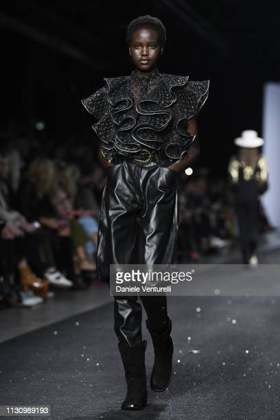 Adut Akech walks the runway at the Alberta Ferretti show at Milan Fashion Week Autumn/Winter 2019/20 on February 20 2019 in Milan Italy