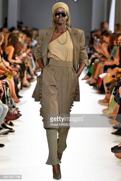 Adut Akech walks the runway at the Max Mara Ready to Wear fashion show during Milan Fashion Week Spring/Summer 2019 on September 20 2018 in Milan...
