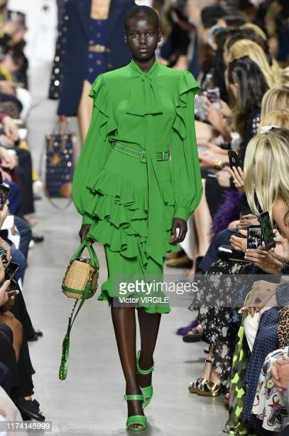 Adut Akech walks the runway at the Michael Kors Ready to Wear Spring/Summer 2020 fashion show during New York Fashion Week on September 11, 2019 in...