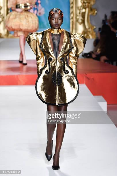 Adut Akech walks the runway at the Moschino show during the Milan Fashion Week Spring/Summer 2020 on September 19 2019 in Milan Italy