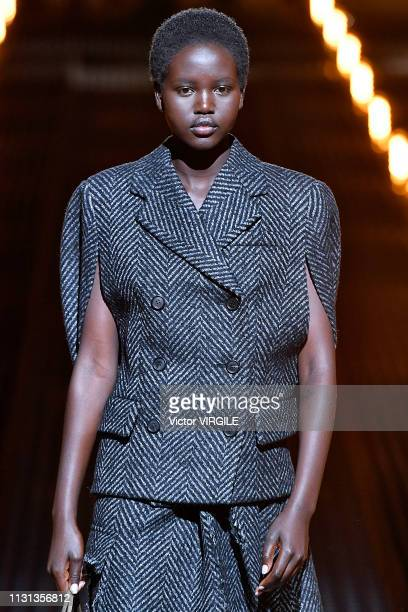 Adut Akech walks the runway at the Prada Ready to Wear Fall/winter 20192020 fashion show at Milan Fashion Week Autumn/Winter 2019/20 on February 21...