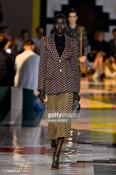 Adut Akech walks the runway at the Prada Ready to Wear Spring/Summer 2020 fashion show during the Milan Fashion Week Spring/Summer 2020 on September...