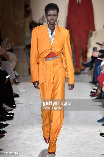 Adut Akech walks the runway at the Salvatore Ferragamo show at Milan Fashion Week Autumn/Winter 2019/20 on February 23 2019 in Milan Italy