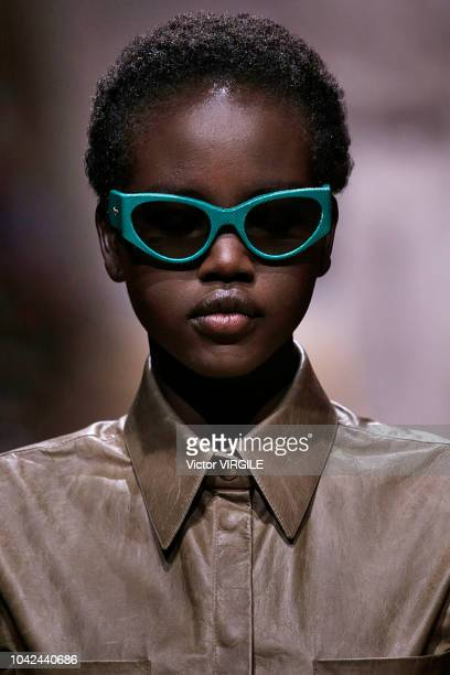 Adut Akech walks the runway at the Salvatore Ferragamo show during Milan Fashion Week Spring/Summer 2019 on September 22 2018 in Milan Italy