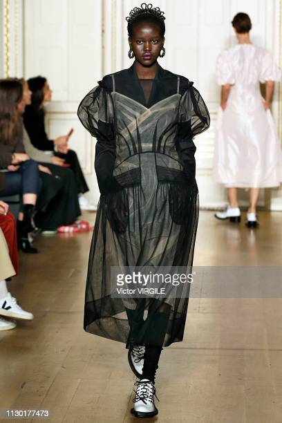 Adut Akech walks the runway at the Simone Rocha Ready to Wear Fall/Winter 20192020 fashion show during London Fashion Week February 2019 on February...